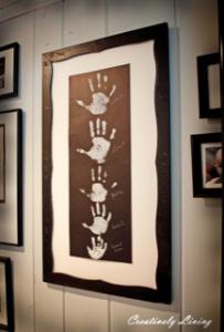 framed photo of handprints