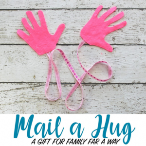 felt hands connected by a ribbon