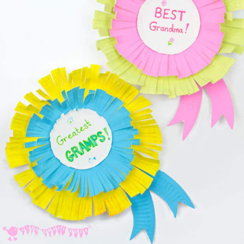 """paper plate rosettes that say """"greatest gramps"""" and """"best grandma"""" in the center"""